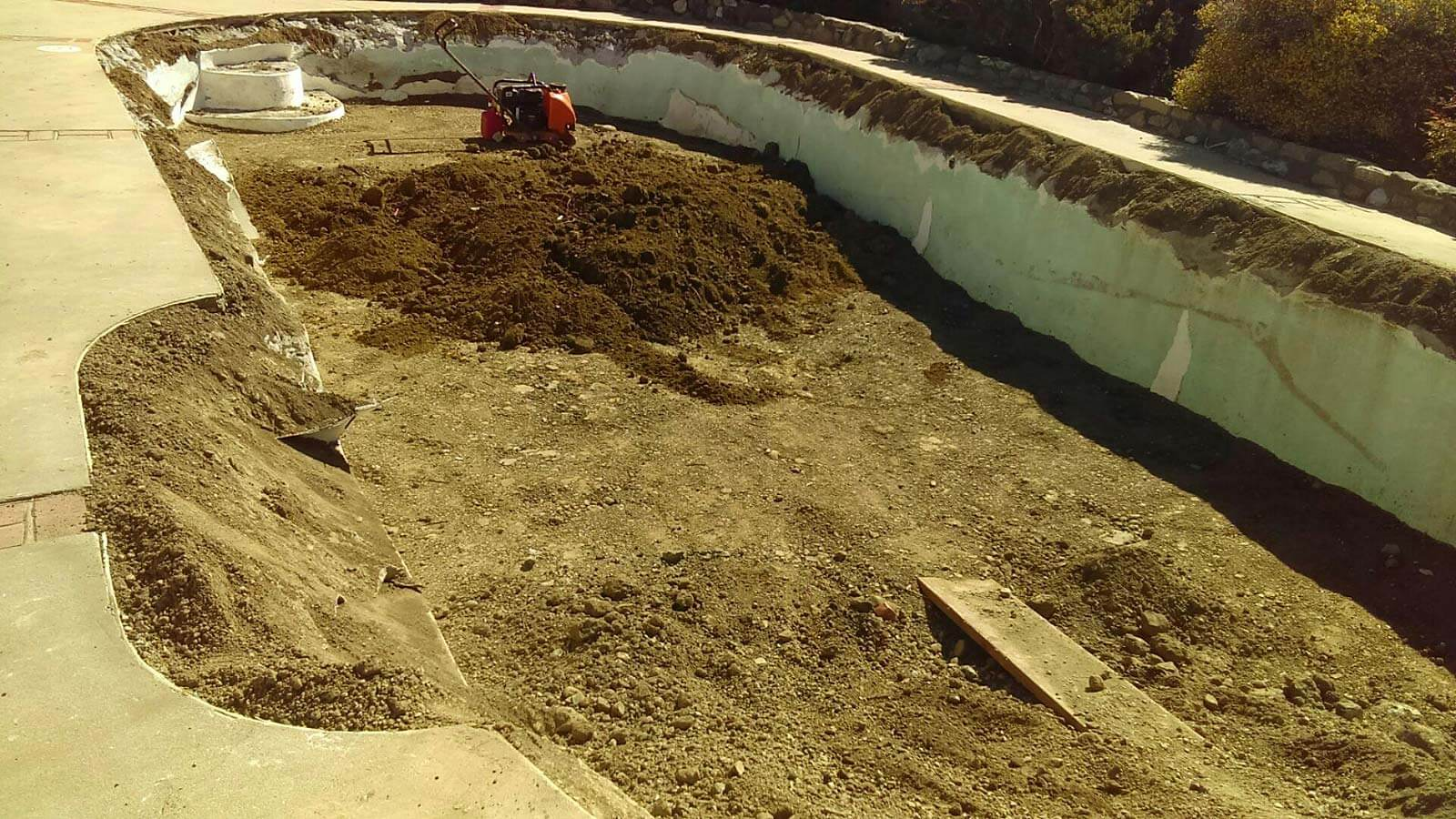 filling a swimming pool with clean dirt