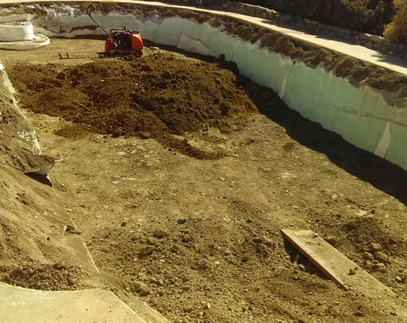 compacting soil during a swimming pool demolition job