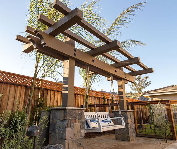 Pergola swing installed after removing a neglected swimming pool in San Jose