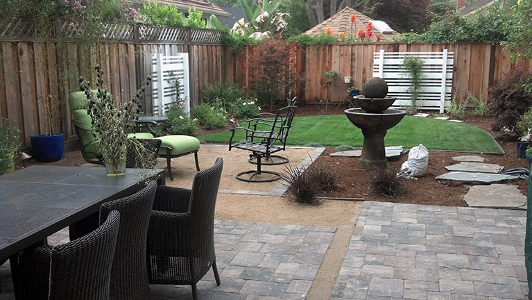 Backyard landscaping in San RAmon with paver patio, lawn, water feature, sitting area, and other decor