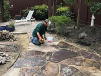 after a pool removal, one of our pros is working on a hardscape