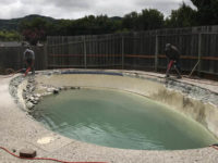 two of our contractors are removing the sides of the swimming pool