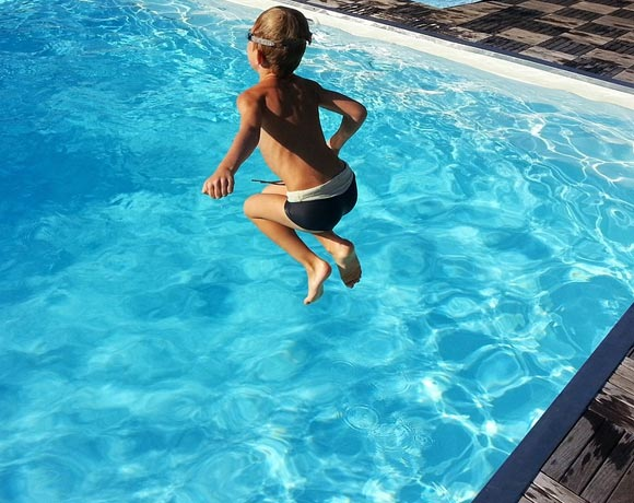 kid jumping in pool