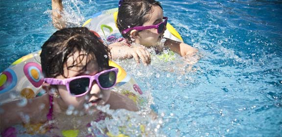 kids swimming at a recreational center